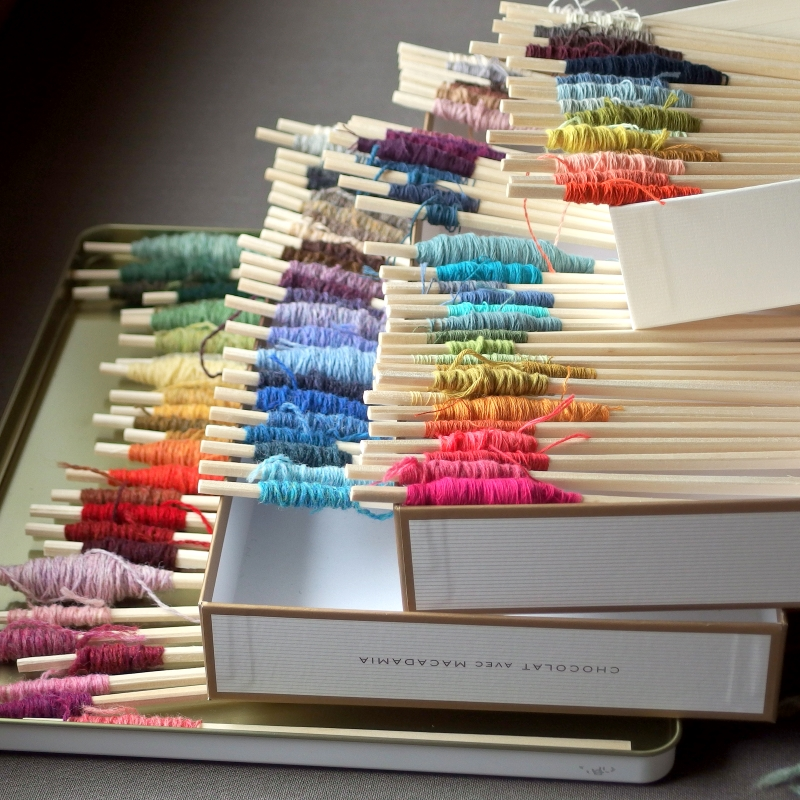 Colourful yarn chopsticks in order